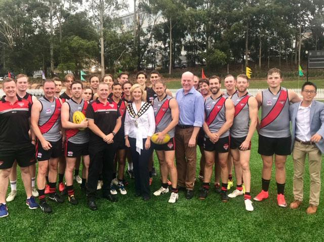 Zhu with local AFL players at the opening of Gore Hill Park